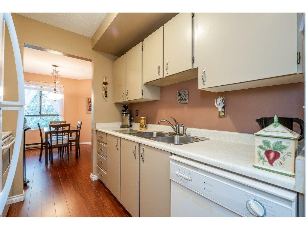 "Photo 4: Photos: 205 7155 134 Street in Surrey: West Newton Condo for sale in ""EAGLE GLEN"" : MLS®# R2446715"