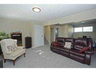 Photo 16: 1404 LAKE MICHIGAN Crescent SE in CALGARY: Lk Bonavista Downs Residential Detached Single Family for sale (Calgary)  : MLS®# C3635964