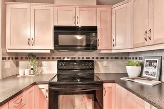 Photo 5: 111 2121 98 Avenue SW in Calgary: Palliser Apartment for sale : MLS®# A1076352