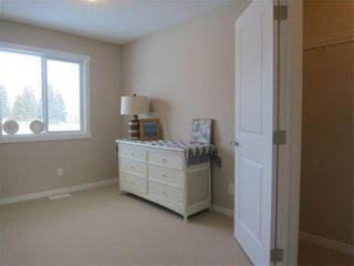 Photo 14: 802 Clover Road: Carstairs Row/Townhouse for sale : MLS®# A1048501