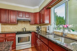 Photo 3: 26335 4 Avenue in Langley: Otter District House for sale : MLS®# R2622320