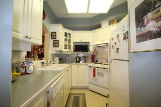 """Photo 1: 103 3621 W 26TH Avenue in Vancouver: Dunbar Condo for sale in """"Dunbar House"""" (Vancouver West)  : MLS®# R2092260"""