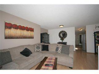 Photo 9: 35 WEST MCDOUGAL Road: Cochrane House for sale : MLS®# C4053037