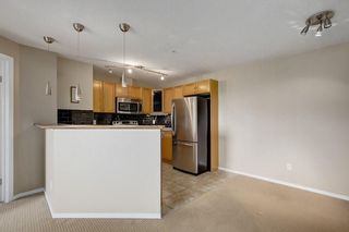 Photo 5: 2308 8 BRIDLECREST Drive SW in Calgary: Bridlewood Condo for sale