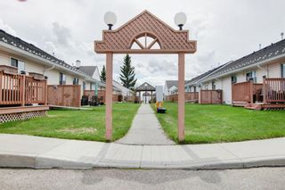 Photo 28: 9 209 Woodside Drive NW: Airdrie Row/Townhouse for sale : MLS®# A1106709