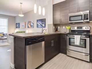 Photo 4: 425 207 SUNSET Drive: Cochrane Apartment for sale : MLS®# C4291361