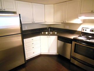 "Photo 2: # 210 2485 ATKINS AV in Port Coquitlam: Central Pt Coquitlam Condo for sale in ""THE ESPLANADE"" : MLS®# V1037424"