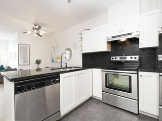 """Photo 12: 406 4550 FRASER Street in Vancouver: Fraser VE Condo for sale in """"Century"""" (Vancouver East)  : MLS®# R2394359"""