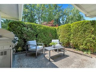 """Photo 25: 28 21746 52 Avenue in Langley: Murrayville Townhouse for sale in """"Glenwood Village Estates"""" : MLS®# R2599658"""