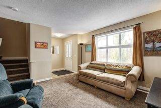 Photo 4: 94 SUNSET Road: Cochrane House for sale : MLS®# C4147363