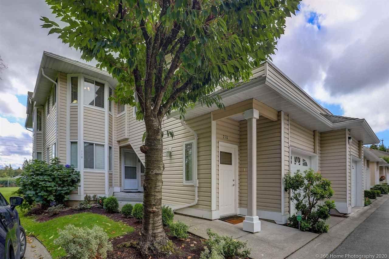 "Main Photo: 210 9310 KING GEORGE Boulevard in Surrey: Bear Creek Green Timbers Townhouse for sale in ""HUNTSFIRLED"" : MLS®# R2507039"