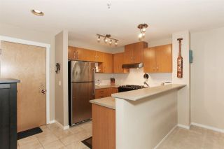 """Photo 10: 209 400 KLAHANIE Drive in Port Moody: Port Moody Centre Condo for sale in """"Tides"""" : MLS®# R2192368"""