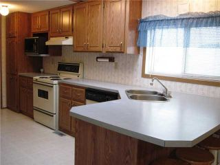 "Photo 3: 22 8420 ALASKA Road in Fort St. John: Fort St. John - City SE Manufactured Home for sale in ""PEACE COUNTRY MOBILE HOME PARK"" (Fort St. John (Zone 60))  : MLS®# N225043"