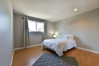Photo 16: 1301 829 Coach Bluff Crescent in Calgary: Coach Hill Row/Townhouse for sale : MLS®# A1094909