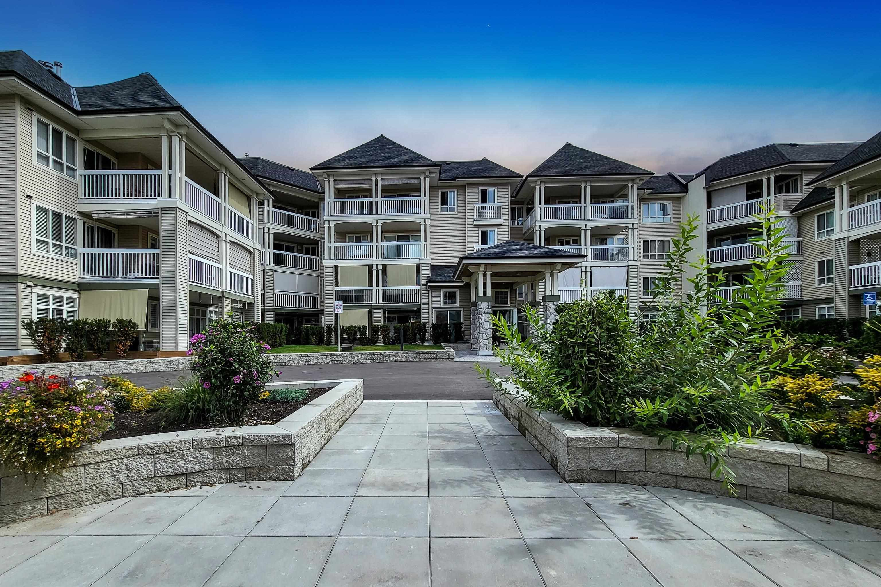 """Main Photo: 407 22022 49 Avenue in Langley: Murrayville Condo for sale in """"Murray Green"""" : MLS®# R2613823"""