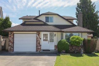 Photo 1: 10821 HOLLYMOUNT Drive in Richmond: Steveston North House for sale : MLS®# R2590985