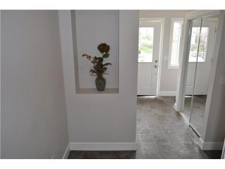 Photo 2: 36 WINDSTONE Green SW: Airdrie Townhouse for sale : MLS®# C3572091