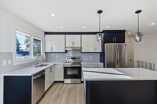 Photo 3: 416 PENWORTH Rise SE in Calgary: Penbrooke Meadows Detached for sale : MLS®# A1025752