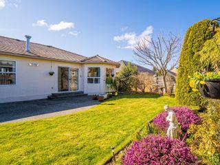 Photo 3: 1069 WINDSOR Dr in : PQ Qualicum Beach House for sale (Parksville/Qualicum)  : MLS®# 869919