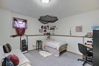 Photo 35: 39 Riverview Close: Cochrane Detached for sale : MLS®# A1079358