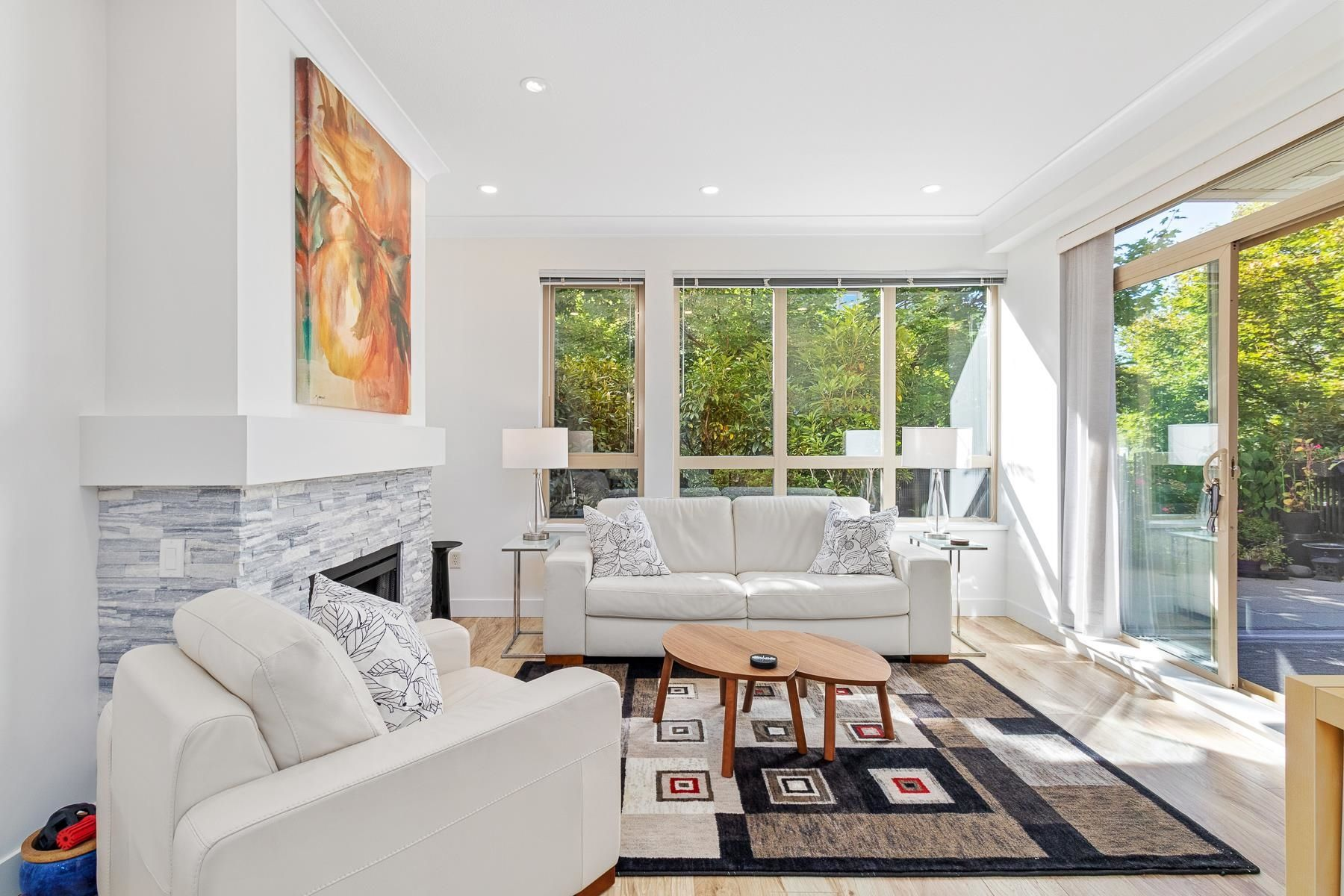 Airy and bright living room with sliding patio doors to expansive deck.