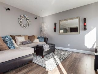 Photo 10: 18 WINDWOOD Grove SW: Airdrie House for sale : MLS®# C4082940