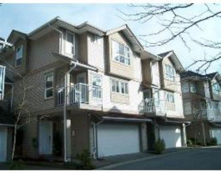 Main Photo: Show Home Condition 3 Level Townhome