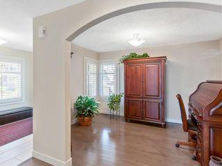 Photo 3: 100 CIMARRON SPRINGS Bay: Okotoks House for sale : MLS®# C4184160