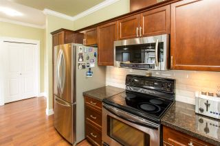 """Photo 9: 408 33338 MAYFAIR Avenue in Abbotsford: Central Abbotsford Condo for sale in """"The Sterling"""" : MLS®# R2456135"""