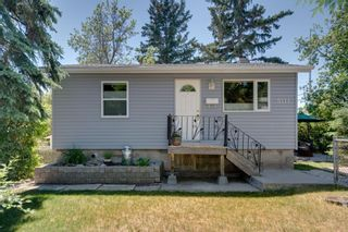 Photo 1: 5111 21 Avenue NW in Calgary: Montgomery Detached for sale : MLS®# A1125320