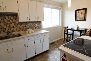Photo 9: 524 34 Avenue NE in Calgary: Winston Heights/Mountview Semi Detached for sale : MLS®# A1078627