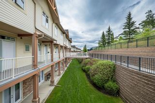 Photo 3: 9 140 Rockyledge View NW in Calgary: Rocky Ridge Row/Townhouse for sale : MLS®# A1118889