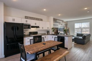 Photo 4: 182 Silverado Boulevard SW in Calgary: Silverado Row/Townhouse for sale : MLS®# A1102908