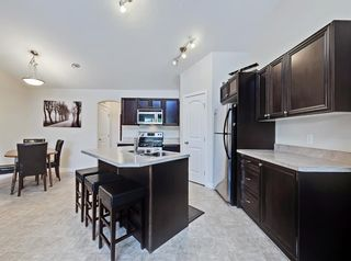 Photo 10: 204 150 PANATELLA Landing NW in Calgary: Panorama Hills Row/Townhouse for sale : MLS®# A1022269