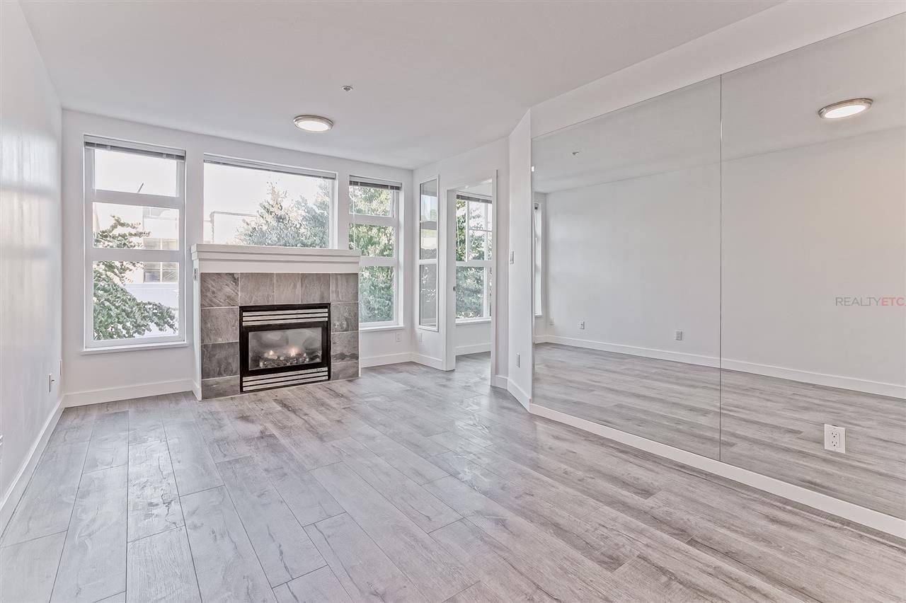 "Main Photo: 212 2102 W 38TH Avenue in Vancouver: Kerrisdale Condo for sale in ""PLATINUM IN KERRISDALE"" (Vancouver West)  : MLS®# R2404597"