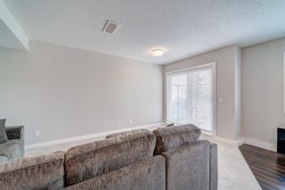 Photo 31: 907 Jumping Pound Common: Cochrane Row/Townhouse for sale : MLS®# A1132952