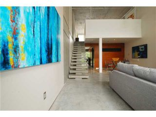 """Photo 4: 203 1540 W 2ND Avenue in Vancouver: False Creek Condo for sale in """"WATERFALL BUILDING"""" (Vancouver West)  : MLS®# V954778"""