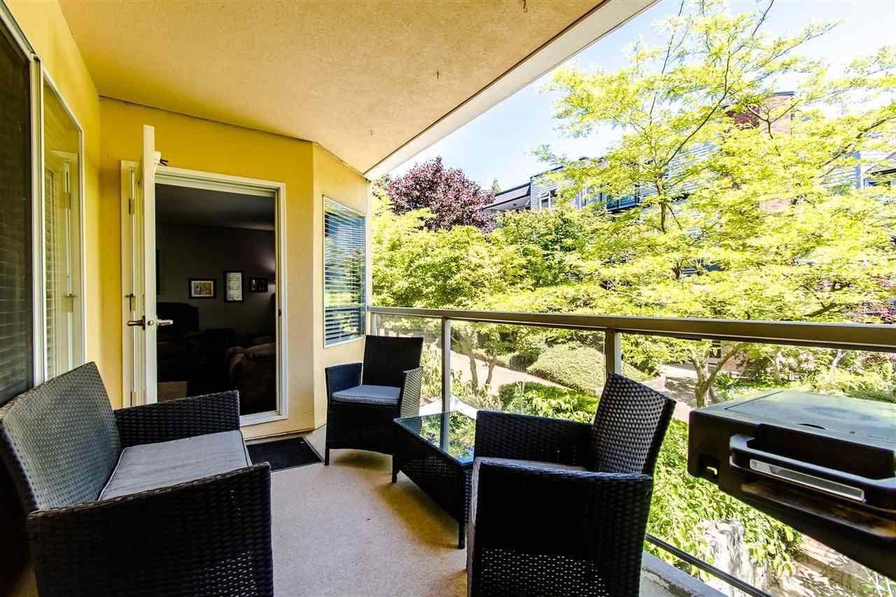 Balcony over looks professionally landscaped greenbelt.