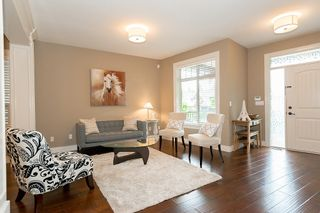 "Photo 3: 1200 BURKEMONT Place in Coquitlam: Burke Mountain House for sale in ""WHISPER CREEK"" : MLS®# V1126988"