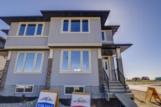 Photo 2: 136 Creekside Drive SW in Calgary: C-168 Semi Detached for sale : MLS®# A1108851
