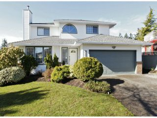 """Photo 1: 1615 143B Street in Surrey: Sunnyside Park Surrey House for sale in """"Ocean Bluff"""" (South Surrey White Rock)  : MLS®# F1406922"""