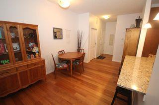 Photo 7: 2101 4 Kingsland Close SE: Airdrie Apartment for sale : MLS®# A1117201