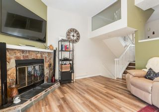 Photo 6: 19 Coachway Green SW in Calgary: Coach Hill Row/Townhouse for sale : MLS®# A1144999