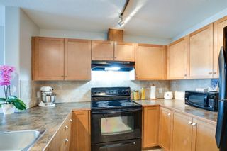 Photo 6: 3310 92 Crystal Shores Road: Okotoks Apartment for sale : MLS®# A1066113
