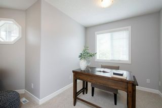 Photo 29: 32 Prominence Park SW in Calgary: Patterson Row/Townhouse for sale : MLS®# A1112438