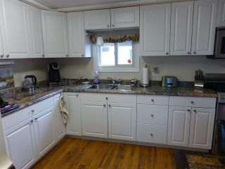 """Photo 2: 13 24330 FRASER Highway in Langley: Otter District Manufactured Home for sale in """"Langley GroveEstates"""" : MLS®# R2224640"""