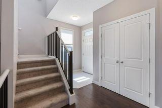 Photo 5: 144 Heritage Boulevard: Cochrane Detached for sale : MLS®# A1125296