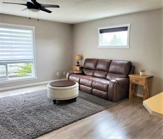 Photo 15: 1404 Clover Link: Carstairs Row/Townhouse for sale : MLS®# A1073804