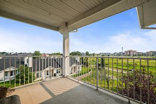 Photo 21: 301 305 1 Avenue NW: Airdrie Apartment for sale : MLS®# A1134588