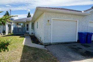 Photo 1: 113 Edgar Avenue NW: Turner Valley Semi Detached for sale : MLS®# A1101043